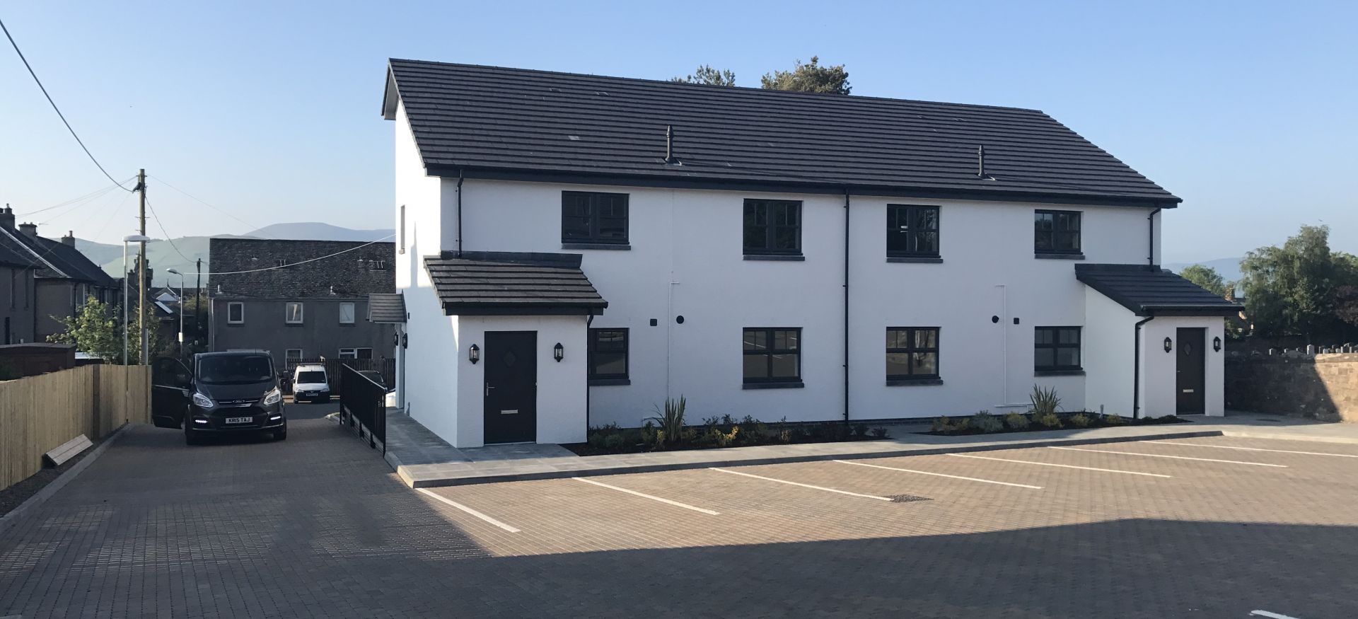 Two blocks of four two-bedroomed flats